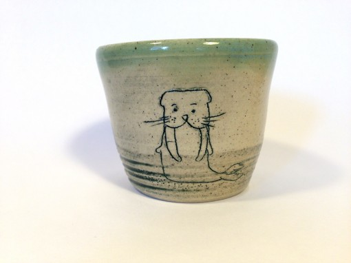 One of a kind small ceramic cup.